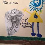 Thomas a dessiné Oiseau Faché et un beau soleil bleu.